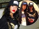Rihanna rocks red lipstick with her Trapstar-designed Monster Tour shirt in NYC after rehearsing with Eminem