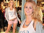 Erin Heatherton and her impressive pins lead a posse of international models at the opening of a clothing store in Brazil