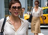 Stylish in the city: Maggie Gyllenhaal looked chic in a loose cream blouse and tan leather-like skirt as she left lunch at Le Pain Quotidien in New York's Soho neighbourhood on Tuesday