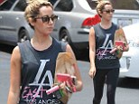 But she's rich and lives in a mansion! Ashley Tisdale tries to look gangster in tank top that represents one of LA's roughest neighborhoods