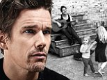 Ethan Hawke plays the guitar while his daughters Clementine, six, and Indiana, three, dance around in a photo feature of Beach magazine's August issue