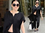 Jessie J parades her toned tum in new York as she steps out in an unbuttoned shirt