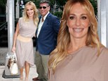 The honeymoon's not over yet! Taylor Armstrong and John Bluher are the picture of newlywed bliss as they leave TV interview
