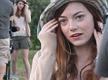 Emma Stone shows off toned pins in khaki green shorts while on the set filming untitled Woody Allen film