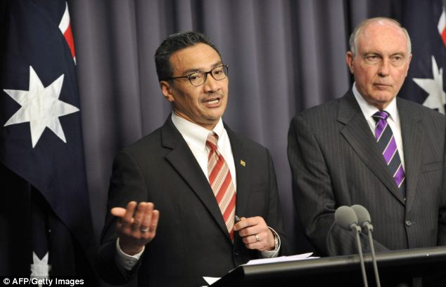Australian Transport Minister Warren Truss, right, pictured with Malaysian Transport Minister Hishammuddin Hussein declined to say whether the cost of the search of MH370 would be split evenly