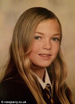 Tormented: Hollie, pictured in year 7 at age 11, said she was the girl who everyone bullied. 'The other kids would call me ugly and say I was a dog. I would be pushed around in the corridors and attacked in the school grounds,' she said