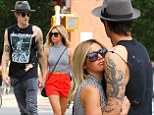 Lovebirds: Ashley Tisdale and her fiance Christopher French were seen hugging each other as they waited for a cab in New York City on Wednesday