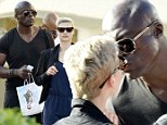 Seal shares a kiss with a young mystery blonde during cosy holiday stroll in Sardinia with his children