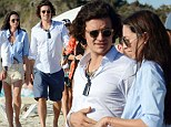 Is this what you call a love square? Orlando Bloom holidays in Spain with Erica Packer after his ex Miranda Kerr is romantically linked to Erica's estranged husband James