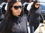 Lean physique: Kim Kardashian showed off her toned figure in a black zip-up and leggings as she headed to the salon in Beverly Hills, California on Tuesday