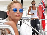 On the yacht: Toni Garrn wore blue mirrored sunglasses on Tuesday while relaxing aboard a yacht with boyfriend Leonardo DiCaprio