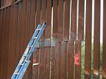 Cut right through: Suspected smugglers made a garage-sized hole in the steel barrier that divides the U.S. and Mexico. It was one of two incidents this past weekend that left parts of the fence down