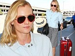 She's a Mad Hatter! Diane Kruger juggles two fedoras as she arrives for flight out of LAX rocking effortlessly chic ensemble