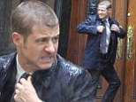 2711600  In need of a cape and cowl! Gotham star Benjamin McKenzie gets soaked as he films Batman prequel in New York