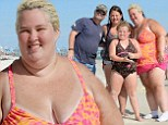 Socks on the beach! Swimsuit-clad Mama June shows off 100lb weight but still hides that 'forklift foot' on Florida holiday with Honey Boo Boo clan