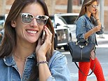 Not afraid to stand out, is she?: Model Alessandra Ambrosio steps out in mirrored sunglasses and very bright orange leggings as she heads to workout