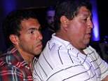 Compassion: Carlos Tevez alongside his father Juan Carlos Cabrera who has been reportedly kidnapped