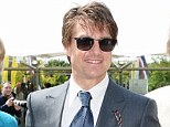 Dress to impress: Tom Cruise is pictured alongside Lord and Lady March at Glorious Goodwood