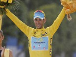 Arms raised: Nibali won the 101st Tour de France by over seven minutes on Sunday