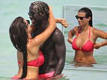Life's a beach: Bacary Sagna and Ludivine on holiday