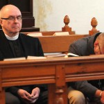 """Two members of the clergy pray during a  """"Healing Prayer"""" memorial service at the St. John's Episcopal Church in the Sandy Hook section of Newtown, Conn. approximately one mile for the Entrance to the scene of the Sandy Hook Elementary School shooting on Riverside Road and  Dickinson Drive in Newtown, Conn.  that claimed the lives of 6 adults and 20 children Friday, December 15, 2012. (Peter Hvizdak/ New Haven Register)"""