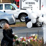 From professional tennis player Andrea Jaeger was so stricken by the deaths of 26 people in Newtown that she flew from Colorado yesterday so that today, Saturday, December 15, 2012 she could  pray, place roses and mementos at a makeshift memorial near the entrance to the scene of the Sandy Hook Elementary School shooting on Riverside Road and  Dickinson Drive in Newtown, Conn.  that claimed the lives of 6 adults and 20 children Friday, December 14, 2012. (Peter Hvizdak/ New Haven Register)