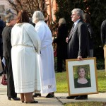 Gilles Rousseau, standing next to clergy, holds a framed photo of his daughter Lauren Rousseau, a victim of the Sandy Hook Elementary School shooting, after her memorial service at the First Congregational Church in Danbury, Conn. Thursday, December 20, 2012. Rousseau was a substitute teacher killed by a gunman that also claimed the lives of 5 other educators and 20 children at the Sandy Hook Elementary School shooting Friday, December 15, 2012.  (Peter Hvizdak/ New Haven Register)