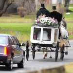 A horse drawn funeral coach carries the body of Sandy Hook Elementary School shooting victim Ana Grace Marquez-Greene from funeral services at The First Cathedral in Bloomfield on 12/22/2012. On the carriage are Randy Franklin (left) and John Allegra (right) of Allegra Farm. (Arnold Gold/ New Haven Register)