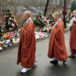 Buddhist monks from the Won Kak Sa monastery in Salisbury visited the makeshift memorial at the entrance to the Sandy Hook School. (Mara Lavitt/ New Haven Register)
