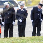 A firefighter with a young boy stands in line with other Connecticut firefighters from around the state as an honor guard during the funeral for David Barden, 7, who was killed by a gunman that also claimed the lives of 6 adults and 19 other children at the Sandy Hook Elementary School shooting Friday, December 15, 2012.  (Peter Hvizdak/ New Haven Register)