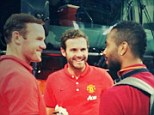 All smiles: Manchester United's Wayne Rooney (left) and Juan Mata (centre) chat with Roma's Ashley Cole