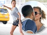She's a real catch! Chrissy Teigen is rewarded with a kiss from husband John Legend after working up a sweat during energetic ball game