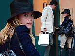 Mary-Kate Olsen, 28, and fiance Olivier Sarkozy, 45, go shopping for cartons of cigarettes on Wednesday
