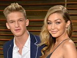 On-off: Model Gigi Hadid, 19, said of her ex-boyfriend, singer Cody Simpson, 17, (pictured together in March), 'He needed his time to focus on his music and he¿s the one who broke up with me'