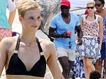 Seal vacations with a mystery blonde in Sardinia