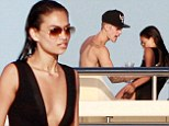 The plot thickens: Now fellow Aussie Victoria's Secret model Shanina Shaik parties on boat with Justin Bieber after his bust up with Orlando Bloom over Miranda