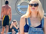 Gwen Stefani gave birth to her youngest son Apollo five months ago and while she's not yet ready to reveal her entire bikini body, she still looked phenomenal in a bikini top and dungarees on Friday. No Doubt's frontwoman, her husband Gavin Rossdale, and their three sons appeared to be loving their quality time together as a family while they splashed around in the beautiful Saint Tropez water.