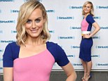 The bright stuff! Taylor Schilling is a far cry from her inmate alter-ego Piper Chapman in multi-coloured clinging frock for radio show