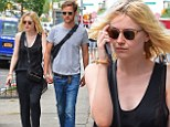 New York is for lovers! Dakota Fanning and boyfriend Jamie Strachan are inseparable while out and about hand-in-hand