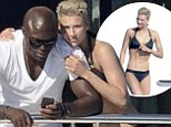 Getting serious? Seal gets cosy with his new bikini-clad girlfriend on a yacht in Sardinia