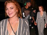 Lindsay Lohan takes the plunge in striped jumpsuit with TOWIE star Vas J Morgan at London club Miabella