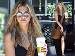 Innocent thighs! Delta Goodrem channels a Seventies goddess in a leg-baring maxi dress just days after her song was dumped by Will.i.am