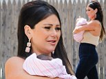 Hello world! Jersey Shore's JWoww already looks fit as she shows off baby girl Meilani for first time in public... two weeks after birth
