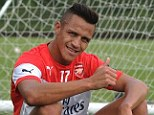 Thumbs up: Alexis Sanchez is set to make his Arsenal debut at the weekend after training on Friday
