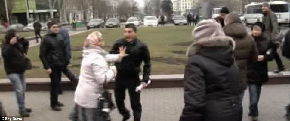 Scuffle: Tensions broke out between pro-Russian protestors and those who support the revolution with this elderly woman taking one on