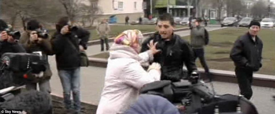 Anger: Wearing a headscarf and pink coat, the older woman was not afraid to take on this man, thought to be a pro-Russian protester