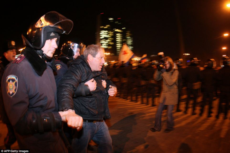 Held: Policemen detain a pro-Russian supporter during clashes between pro-Ukrainian and pro-Russian activists