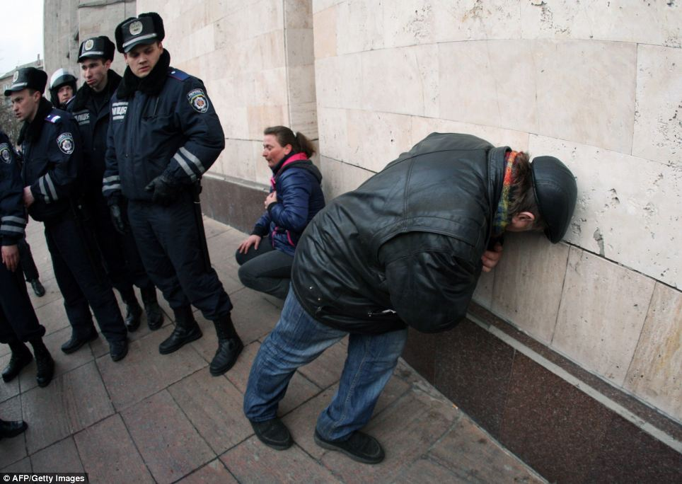 Hurt: Two pro-Russian protesters recover from their injuries after clashes with police