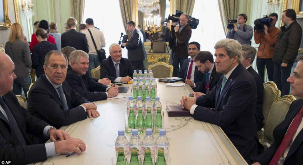 Tete a tete: US Secretary of State John Kerry and Russian Foreign Minister Sergei Lavrov meet at the Russian Ambassador's Residence in Paris