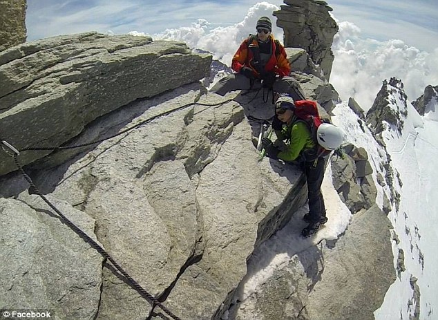 Mountain men: Patrick Sweeney and P.J. pictured at the summit of Italy's Gran Paradiso